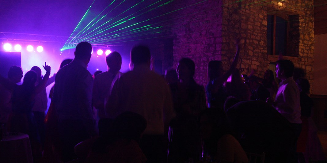 Funky purple lighting with strobe for evening party in the Tythe Barn