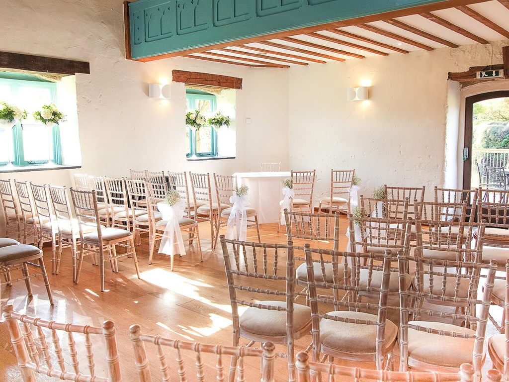 Ceremony laid up in the Watermill with white chiavari chairs