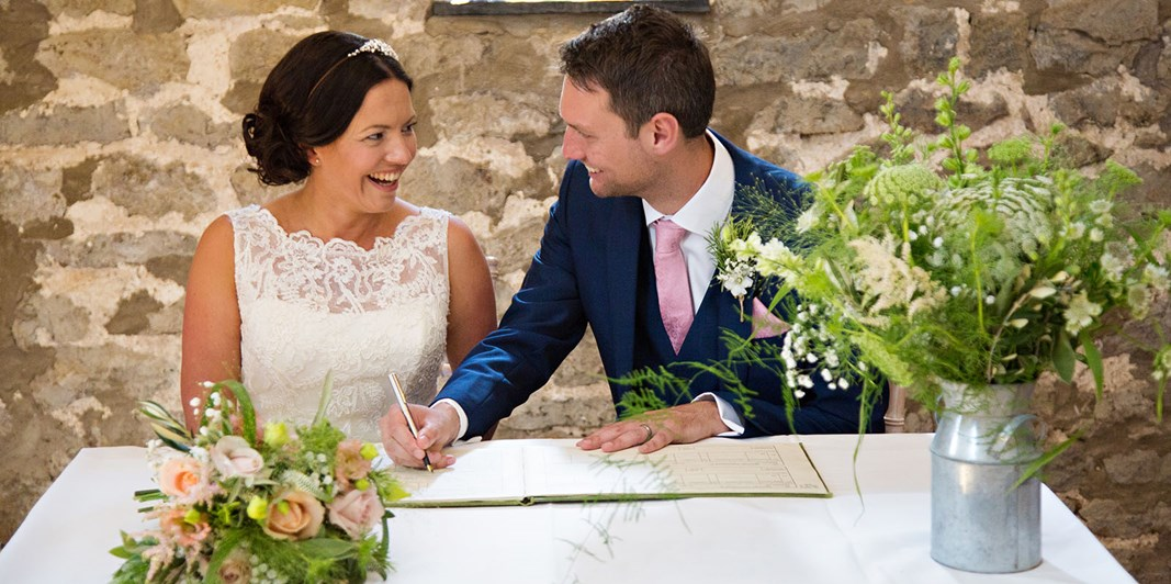 Signing the register in the Tythe Barn