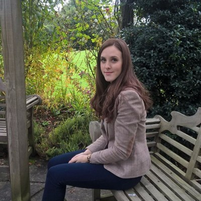 Laura Langley sits in the Watermill garden