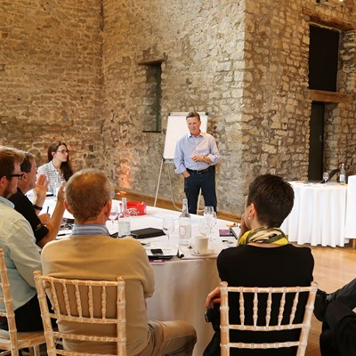 Speaker holds forth at a seminar in the Tythe Barn
