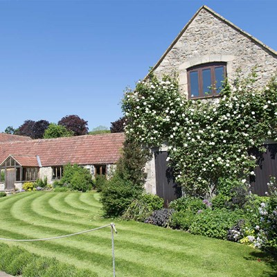 Mown lawn beside the Tythe Barn