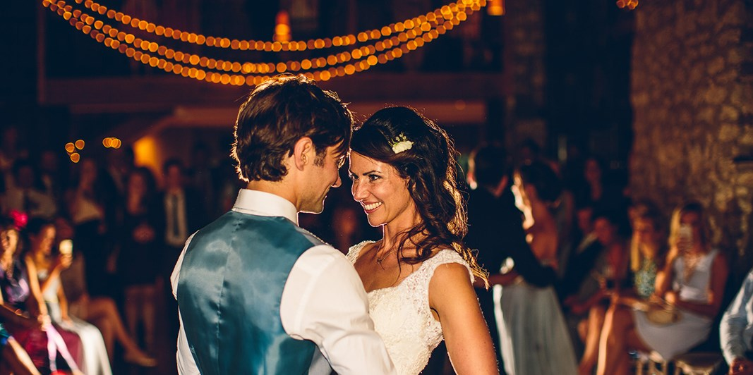 Couple have their first dance in the Tythe Barn
