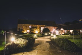The Tythe Barn wedding venue in Bath at Priston Mill at night time