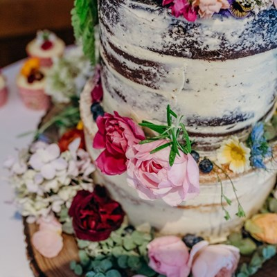 Colourful naked cake at Priston Mill wedding venue