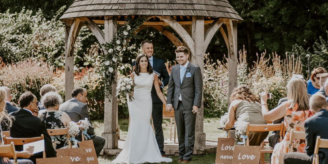 Newly married couple at Priston Mill wedding venue in Bath