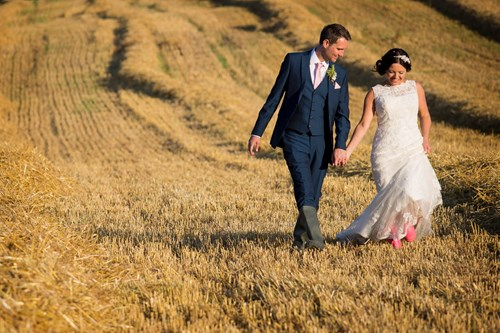 Couple walking at wedding in Priston Mill wedding venue