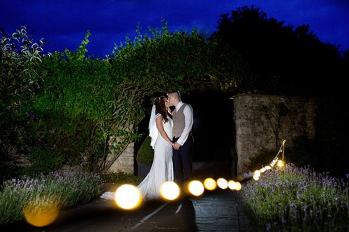 Bride and Groom kissing at Priston Mill
