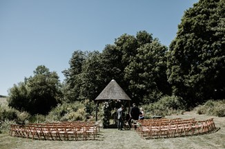 wedding ceremony in the watermill gardens at Priston Mill